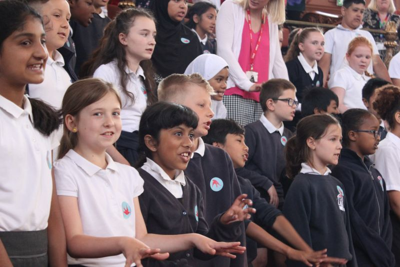 Pupils singing at multilingual concert
