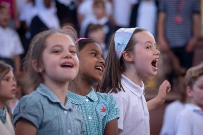 Children singing at the multilingual concert